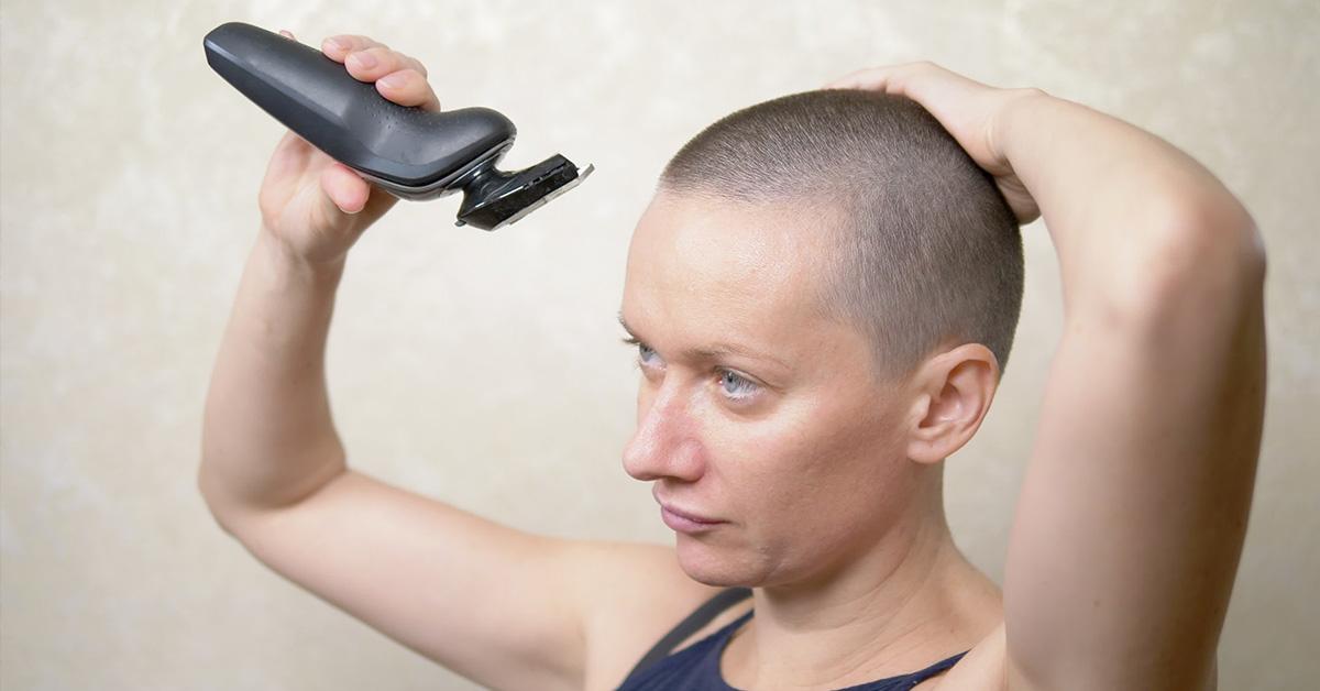 woman shaving head
