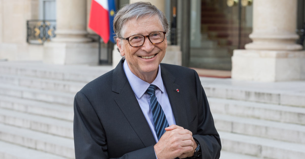 Bill Gates with French flag behind him