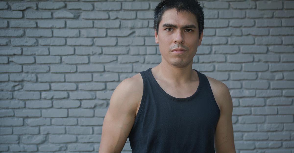 man in black undershirt