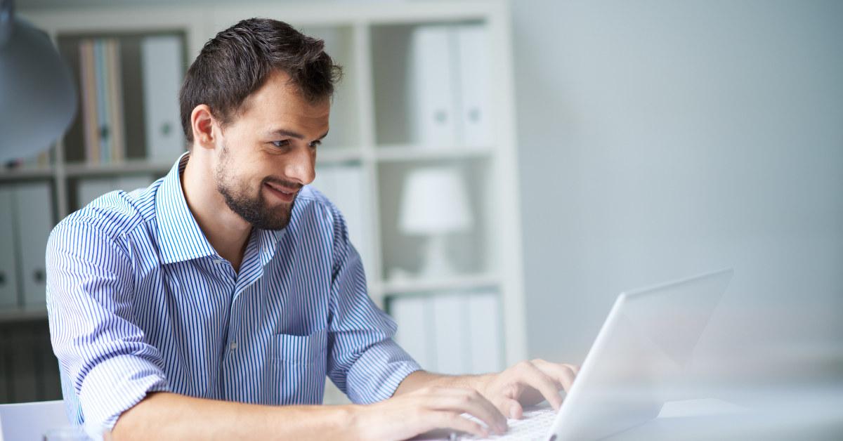 man using white laptop